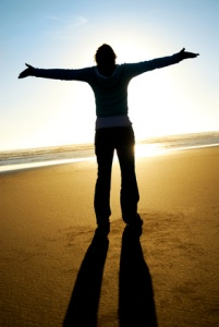 Man on beach freedom